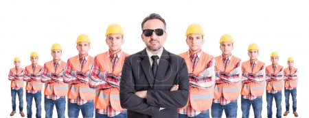 Executive manager with team of builders behind