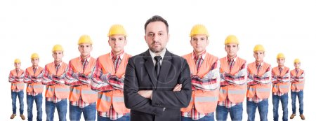 Confindent business man and a team of construction workers