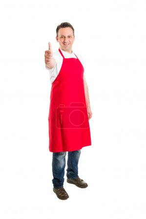 Butcher or supermarket worker showing thumbs up