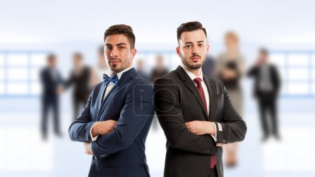 Business people back to back