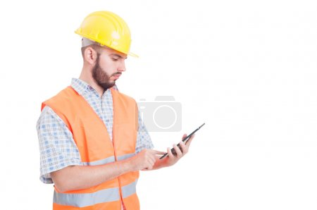 Smart and modern builder or engineer using tablet