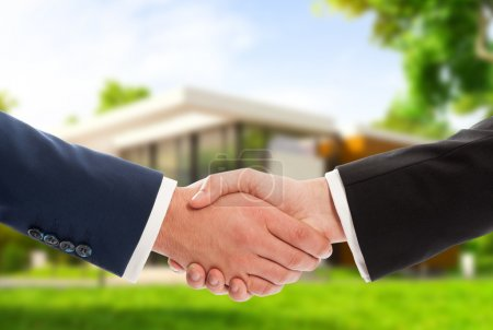 Handshake on house outdoor background