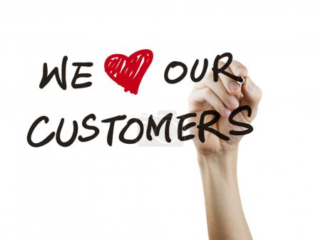 Photo for We love our customers words written by hand over white background - Royalty Free Image