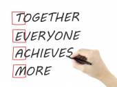 Together Everyone Achieves More written by mans hand