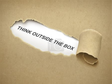 Paper torn to reveal phrase think outside the box