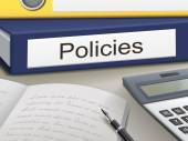 Policies binders isolated on the office table