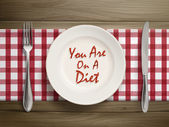 Top view of you are on a diet written by ketchup on a plate over wooden table