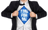 businessman showing Time for me words underneath his shirt