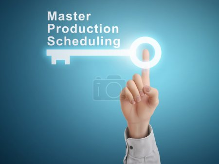 Male hand pressing master production scheduling key button