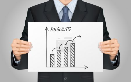 businessman holding results graph
