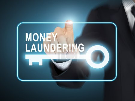 male hand pressing money laundering key button