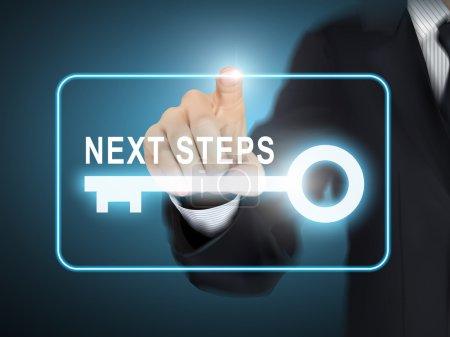 male hand pressing next steps key button