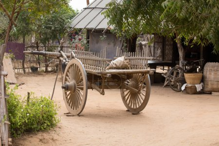 Yard with a wooden cart. Bagan, Myanmar