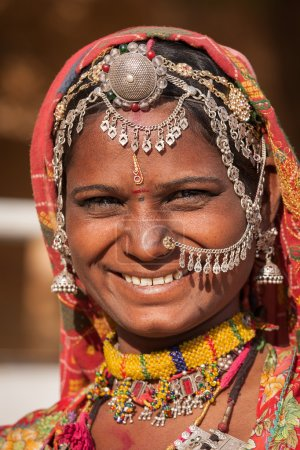 Indian woman in colorful ethnic attire. Jaisalmer, Rajasthan, India