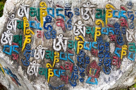 Photo for Prayer stones as a form of prayer in Tibetan Buddhism, on the hill in Himalaya mountains. Mcleod Ganj, Dharamsala, India. - Royalty Free Image