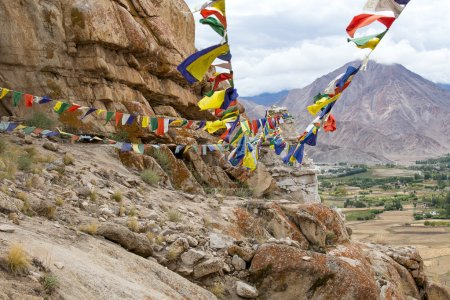 Plenty of colorful Buddhist prayer flags on the Stupa near Takthok gompa, Buddhist monastery in Ladakh, Jammu & Kashmir, India