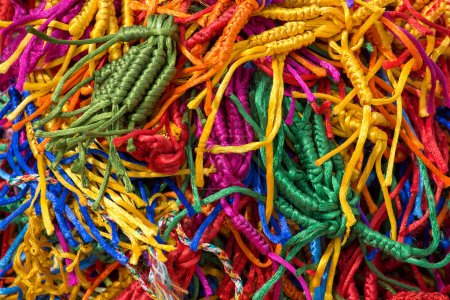 Photo for Lots of colorful, wicker bracelets on buddhist market near the temple in Dharamsala, India - Royalty Free Image