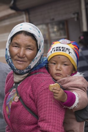 Portrait local woman with child on the street in Leh, Ladakh. India