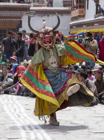 Tibetan Buddhist lamas in the mystical masks perform a ritual Tsam dance . Hemis monastery, Ladakh, India