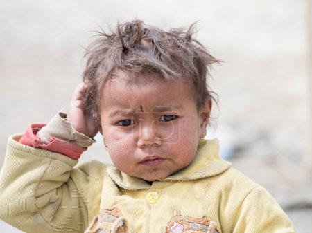 Portrait poor young boy in India