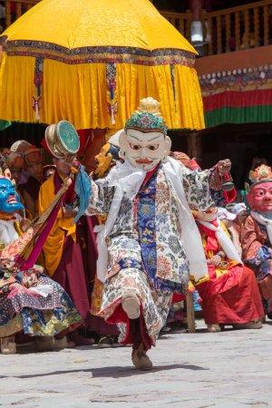 Tibetan Buddhist lamas in the mystical masks perform a ritual Tsam dance . Hemis monastery, Ladakh, India
