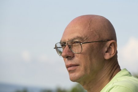 Close up portrait of middle-aged man relaxing in nature
