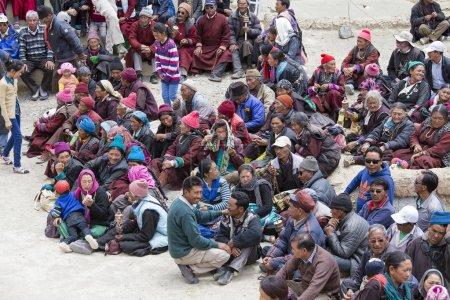 Tibetan old people during mystical mask dancing Tsam mystery dance in time of Yuru Kabgyat Buddhist festival at Lamayuru Gompa, Ladakh, North India