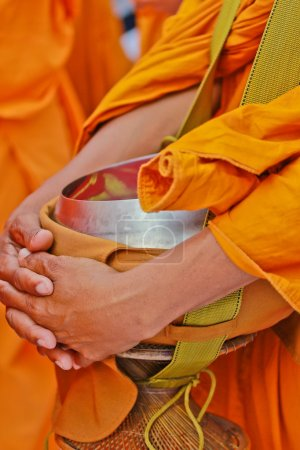 Buddhist monk with alms bowl