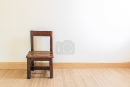 Old wooden chair on laminate flooring
