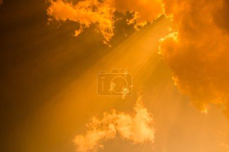 Rays of light shining through dark clouds