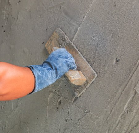 man with plasterer concrete