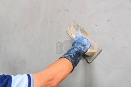 Worker hand with trowel