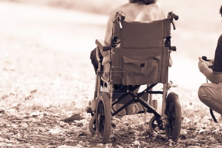 cripple sitting in wheelchair
