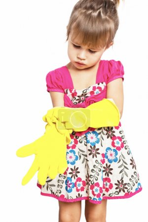 Little girl in rubber gloves in on the white background