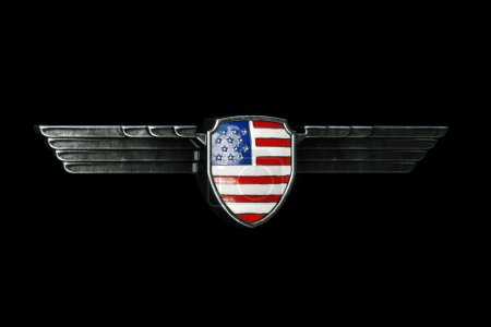 USA flag in metal wings frame isolated on black background. Pers