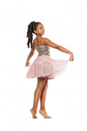 Photo for Beautiful little girl dancing on a white background - Royalty Free Image