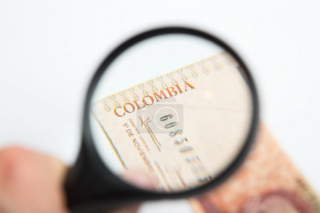 Magnifying Glass on the Colombian Pesos.