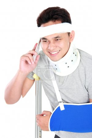 young man with broken arm talking on the phone