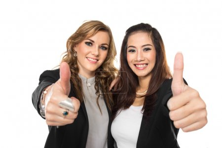 young business woman making thumbs up gesture wearing blouse and