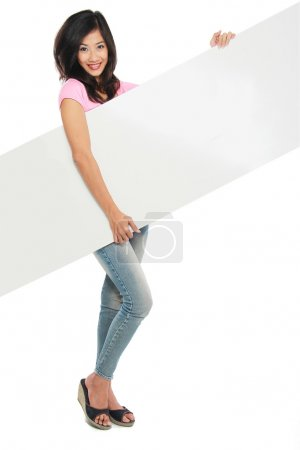 Photo for Young beautiful woman holding blank white card against white background - Royalty Free Image