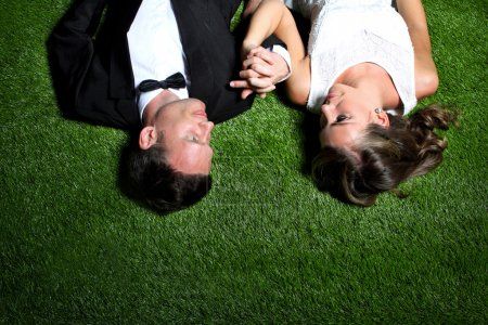 amazing couple lying on the grass