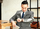 businessman looking at his watches waiting for appointment with