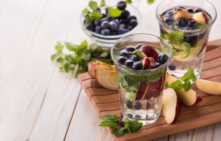 Summer fresh fruit drink. fruit Flavored water mix with apple, b