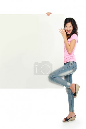 Asian young woman smile brightly while holding a balnk white boa