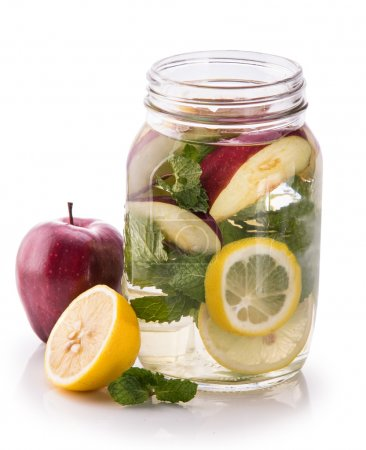 Infused fresh fruit water of lemon, apple and mint leaf. isolate