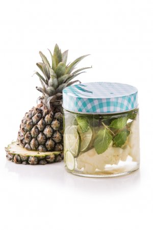 Infused fresh fruit water pineapple, lime and mint.isolated over