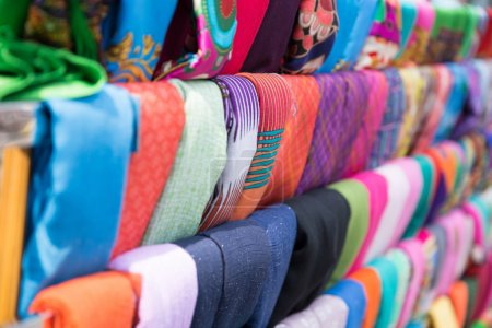 The colored scarfs in rows in market