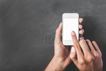 hands holding and touching the screen of mobilephone with white