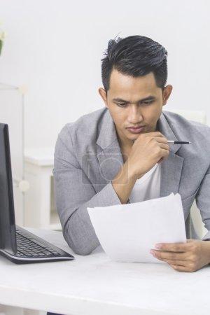 businessman working with paperwork