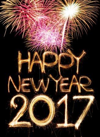 Photo pour Bonne année 2017 mot fabriqué à partir de feux d'artifice de lumière scintillante - image libre de droit